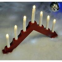 Modern red design candle bridge , a modern look at a traditional Christmas ornament . works with batteries so no need to have an electric socket