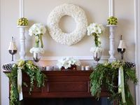 Winter white flower wreath, candles, greenery. This is pretty for the new year!