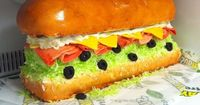 This giant Subway sandwich cake was made for my brother in law who owns and operates a Subway shop. I took on this project when I was still a beginning decorato