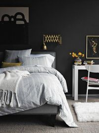 When it comes to bedroom colors, there's generally two routes to take: serene light or cozy dark