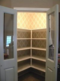 wallpaper in pantry - makes pantry look so awesome!