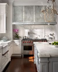 O'Brien Harris: Modern French kitchen with floor to ceiling white kitchen cabinets paired with marble ...
