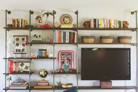 living room wall: bookshelves & TV stand