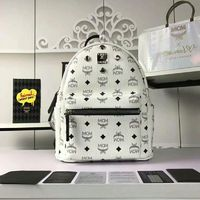 MCM Small Stark Four Odeon Studs Backpack In White