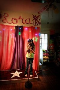 On Stage in the Playroom, I transformed my daughters playroom into a stage for a budding star!, The stage is a simple box made of plywood. The builder (family friend) stained it and actually carved it to make it look like wooden plank., Other Spac...
