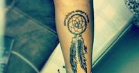 Love the placement of this Dream Catcher tattoo... I would change the wording tho to make it my own and personal to me.