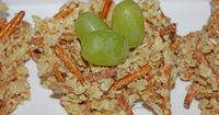 yum!! rice krispy, golden graham and pretzel stick nests with grape eggs. a wonderful treat for the classroom!!! ON THE BLOG