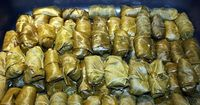 "Stuffed Grape Leaves...in my Armenian family we call these ""sarma"" or ""dolma"" and we use hamburger and italian seasoning and add the tomato sauce to the meat mixture and cook them in water, no sauce...DELICIOUS!!"