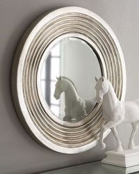 "Silver Deco Mirror at Horchow. Make a statement and reflect the beauty of your surroundings with this massive beveled mirror. Imported. Made of polyurethane. Antiqued-silver finish. Metal hanger included. 39.75""Dia. x 2.5""D. 395$"