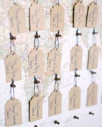 Check out these escort cards pinned to a world map in this DIY Wedding in Milwaukee