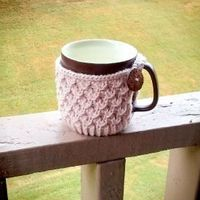 Keep your beverage warm with this knitted mug cozy! thanks so for freebie xox