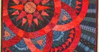 Judy Mathieson's entry into the WSQC is Scarlet and Indigo. She finished her quilt first - see Click on the quilt to see it bigger. The quilting is amazing. I wish my echo quilting was that good.