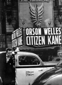 Orson Welles arrives by taxi to the Citizen Kane premiere, 1941.