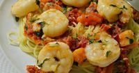 Shrimp and sun-dried tomatoes are cooked in a light garlic and olive oil sauce and served over angel hair pasta.
