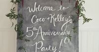 Cute chalkboard welcome sign with florals.