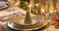 Elegant Christmas in twinkling Gold, with lots of candles and glittering topiary Christmas Trees. See my board ~Tree Ornaments and Topiary~ for DIY topiary trees for you to craft. via South Shore Decorating Blog: Home Goods Holiday Tables