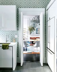 light blue diamond pattern wall. White modern kitchen flat front cabinet doors cabinets cabinetry. Almost sea foam green color. Is this wallpaper or mosaic tile...I can't tell?