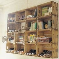 Wooden crates stacked on top of each other to create a unique storage space. Looks neat!
