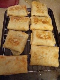 Stir together Cream Cheese, Shredded Cheese, and Taco Seasoning. Fold in the shredded meat, Divide the mix into the tortillas and roll up. Spray the tops with cooking spray and bake for 30 minutes at 350. (flip them at 15 minutes) Garnish with sou...