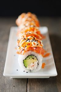 a volcano of amazeballs in one biteVolcano Roll Sushi[print recipe]4 cups cooked sushi rice (see below)2 cups spicy tuna1 cup crab salad1 cup mayonnaise2-4 tbsp