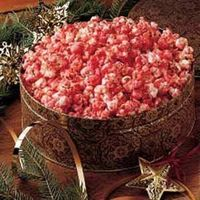 This crisp bright-colored snack is more festive than traditional caramel corn. My family just loves it! Set out in pretty bowls, it makes a tasty table decorati
