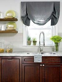 Interesting Texture In a classic kitchen with cherry cabinets, the marble countertops, gray linen roman shade, and raw-wood shelves all add interesting textures to the room. This small amount of juxtaposition with the traditional cabinets creates great co...