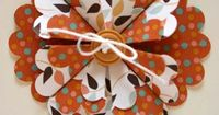 Scallop Punch Flower. To make the scallop punch flower, first count out five scallops and fold that portion down. Turn this over and fold in half to form crease in the middle, then unfold. Fold flat edges down from each side to line up with the center cre...