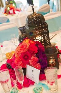 Lanterns and flowers for your tables! :) #weddingdecor #indianwedding