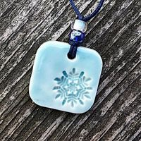 Light blue polymer clay square pendant with snowflake
