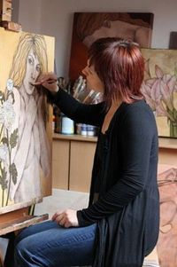 artist painting a portrait in the studio