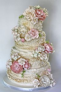 sugar flowers decorated ruffled wedding cake by Coco Paloma Desserts (Texas) #cake #fondant #gumpaste