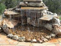Instead of buying an expensive kit to build a pondless waterfall, consider using less expensive but still quite effective materials found at a local hardware st