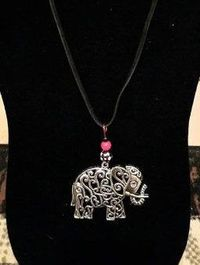 Large Silver Filigree Elephant Necklace with black, gingham, and red beading. $12.00