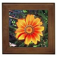 Brighten up any environment with this ceramic tile that encapsulates the design of the artist. This item also includes a wood colored frame giving it a complete finish. Printed on the tile using a heat dye sublimation technique, the image is protected fro...