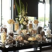 candy bar in the wedding colors, in apothacary jars or mercury glass or combo.