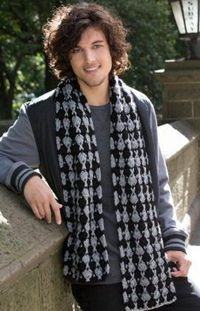 Great for men and women alike, this Japanese Fan Crocheted Scarf is a great winter or fall accessory. Decorated with little crocheted fans, this scarf is artist