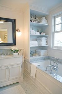 Dream bathroom, love love love crown molding and wall paneling. Love the built in storage!