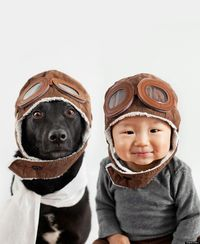 Adorable photo project by photographer a Grace Chon - series of photos of her son and their rescue dog in various hats