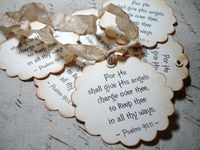 used a scalloped punch and Bible verses to create tags or ornaments