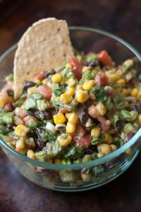 Ingredients 1- 15 oz can corn 1 can black beans 2 avocados (cubed) 2/3cup chopped cilantro 8 green onion stalks sliced 6 roma tomatoesDressing: 1/4 cup olive oil 1/4 cup red wine vinegar 2 cloves mincedgarlic 3/4 teaspoon salt 1/8 teaspoon pepper ...