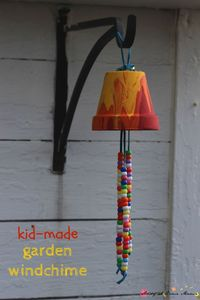 Kids Craft Idea: Homemade Garden Wind Chime, a sweet gift and a great way to decorate your garden using pour painting process art and hand-strung beads