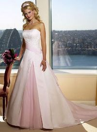 Pretty, pale pink strapless wedding gown with split skirt
