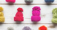 Whip out these easy to make yarn hats to decorate packages this Christmas. They'd work for a winter birthday present also!