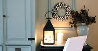 Lights in a lantern and framed wreath
