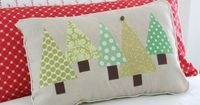 Triangle Trees (for Christmas? ; ) no tutorial, but I think this would be an easy one to design and make. Kind of retro : ) With double fused iron-on mesh it would be easy to convert pillows you already have.