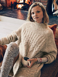 Super cozy tunic sweater featuring a marled knit and a mock neck. High low hem with side vents and ribbed trim.