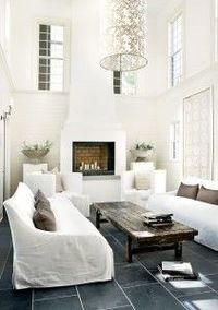Elegant white living room with mosaic tiles flooring
