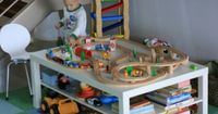 IKEA Lack coffee table turned into a train table. Would be cute as half train table, half Lego table.