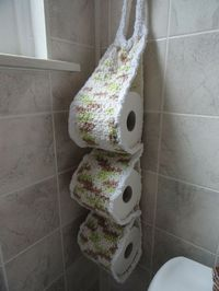 Crocheted Toilet Paper Roll holder - **Inspiration** our new house has a 1/2 bath that is super tiny and has no cabinet under the pedestal sink. I have been in search for ways to add color to the room and also need a place to store extra rolls of toilet p...