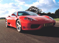 Ferrari 355 experience at Thruxton Circuit The famous horse prances on your steering wheel, the pedigree engine roars in your ears and the race track curves away in front of you. Your unforgettable Ferrari racing experience has begun. The 355 http://www.c...